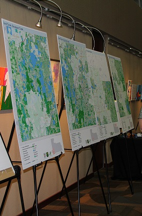 Several maps are on display on easels