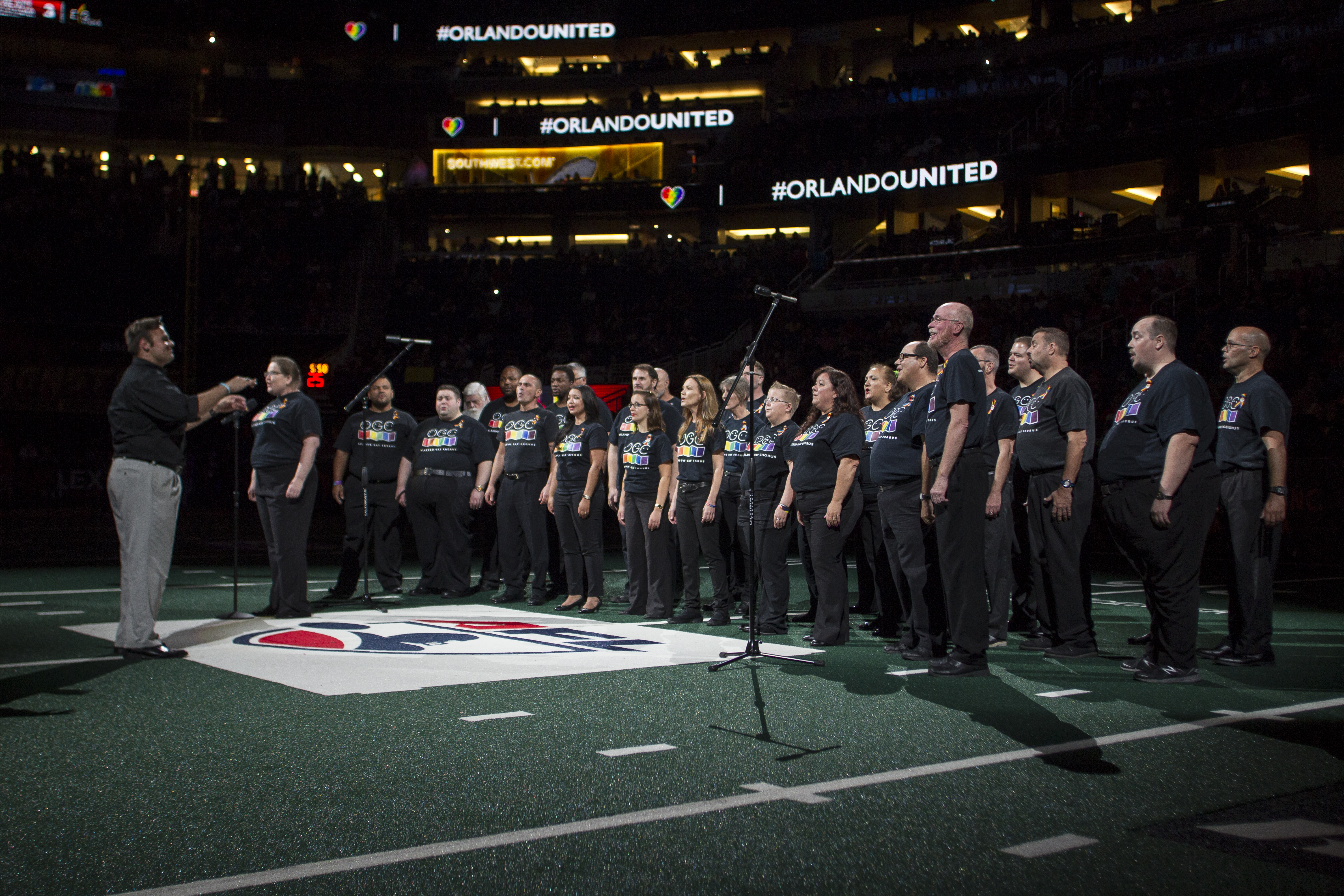 Choir singing in the middle of a stadium